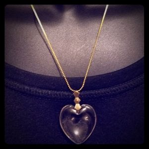 18in gold tone chain with a glass clear type heart